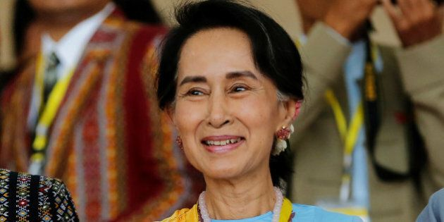 Myanmar State Counsellor Aung San Suu Kyi smiles as she attends a photo opportunity after the opening...
