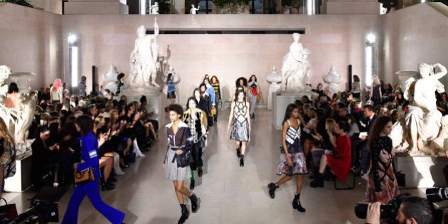 PARIS, FRANCE - MARCH 07: A wide shot of models walking the runway during the finale of the Louis Vuitton...