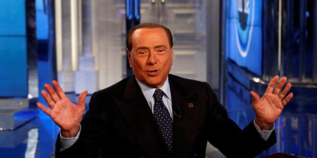 Italy's former Prime Minister Silvio Berlusconi gestures as he attends television talk