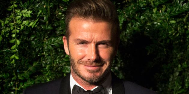 Former British soccer player David Beckham smiles at the Evening Standard Theatre awards in London November...