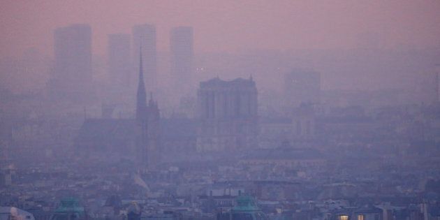 A small-particle haze hangs above the skyline in Paris, France, December 9, 2016 as the City of Light experienced the worst air pollution in a decade. At L, the Notre Dame Cathedral. REUTERS/Gonzalo Fuentes