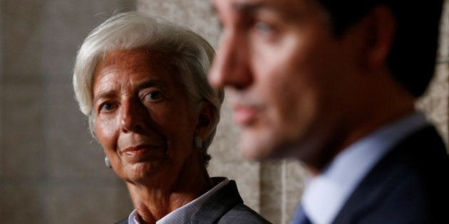 International Monetary Fund (IMF) Managing Director Christine Lagarde (L) listens to Canada's Prime Minister...