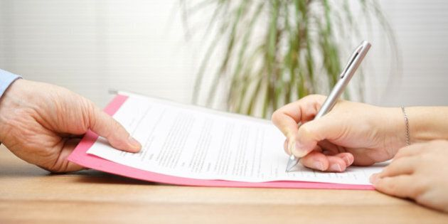 boss gives employee dismissal contract to sign