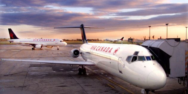 Air Canada jets are seen as the sun rises at Montreal's Dorval airport,September 26, 2001. Air Canada...