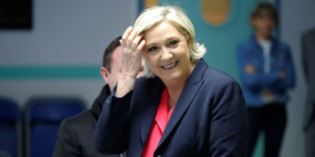 Marine Le Pen, French National Front (FN) political party candidate for French 2017 presidential election, smiles before voting in the second round of 2017 French presidential election at a polling station in Henin-Beaumont, France, May 7, 2017. REUTERS/Charles Platiau
