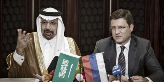 Khalid Bin Abdulaziz Al-Falih, Saudi Arabia's energy minister, left, speaks as Alexander Novak, Russia's...