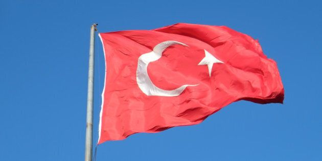 Turkish flag waving in the blue sky, Istanbul,