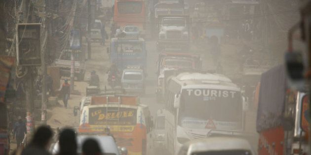 Dust blows as vehicles run along a road in Kathmandu, Nepal February 27, 2017. Picture taken February...