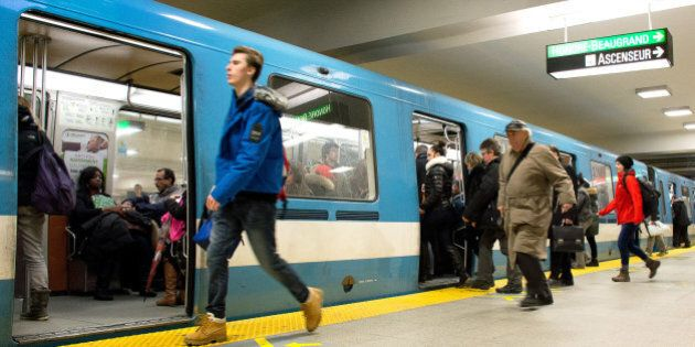 Montreal, PQ, Canada - December 2, 2015: People exit and board a train on Berry-UQAM subway station in Montreal