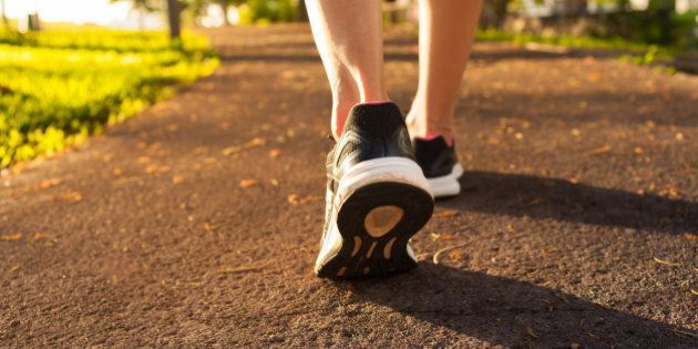 Close up woman walking on a path. Fitness