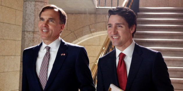 Canada's Prime Minister Justin Trudeau (R) and Finance Minister Bill Morneau walk to the House of Commons...