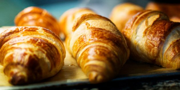 Freshly baked croissants for sale at a deli