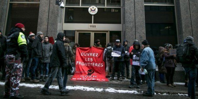 MONTREAL, CANADA - JANUARY 30 : Demonstrators hold a banner in front of the Consulate of the United States...