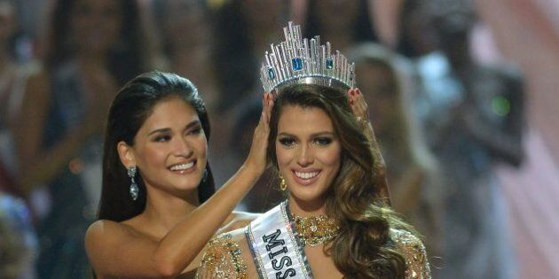 Miss Universe contestant Iris Mittenaere (R) of France is crowned the new 2017 winner by former Miss...