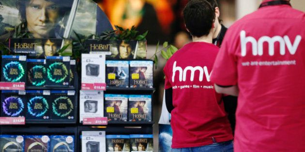 Employees prepare a branch of struggling music retailer HMV as it opens for the day's trading on Oxford...