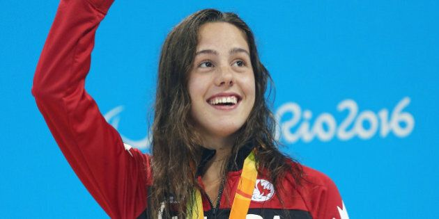RIO DE JANEIRO, BRAZIL - SEPTEMBER 11:  Silver medalist Aurelie Rivard of Canada celebrates on the podium at the medal ceremony for Women's 200m Individual Medley - SM10 on day 4 of the Rio 2016 Paralympic Games at the Olympic Aquatic Stadium on September 11, 2016 in Rio de Janeiro, Brazil.  (Photo by Buda Mendes/Getty Images)