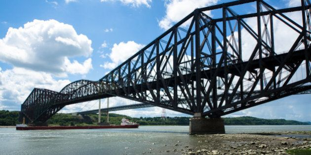 The Quebec Bridge is a combined road and rail bridge across the St. Lawrence River west of Quebec City....