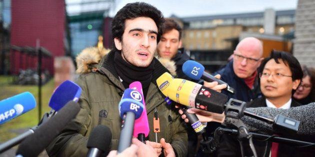 WURZBURG, GERMANY - FEBRUARY 06: Lawyer Chan-Jo Jun (R) and the Syrian refugee Anas Modamani (C) speaks...