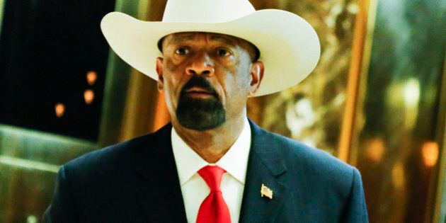 Milwaukee Sheriff David Clarke (L) exits elevators after meetings with President-elect Donald Trump November...