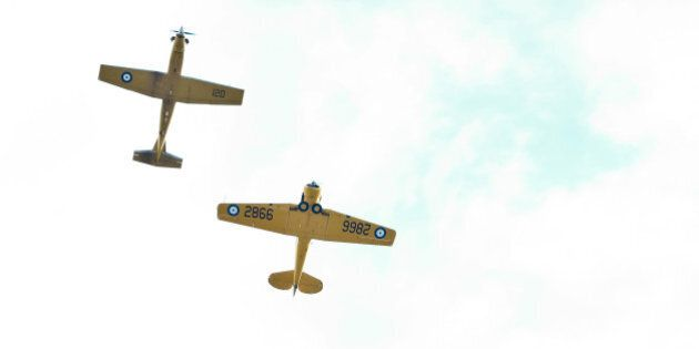 WINNIPEG, MB - OCTOBER 22: Two Royal Canadian Air Force CT 156 Harvard II aircrafts fly over during the...