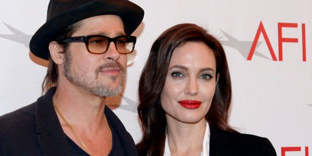 Actor Brad Pitt and actress/director Angelina Jolie pose at the AFI Awards 2014 honoring excellence in...