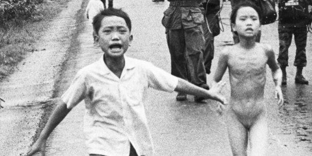 (Original Caption) 11/3/1972-Trang Bang, South Vietnam: Children run along Highway 1 June 8, 1972 in...