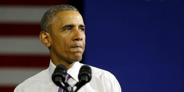 U.S. President Barack Obama pauses during remarks about health insurance marketplace enrollments and...