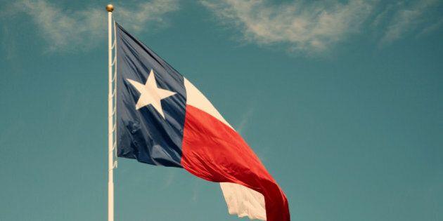 State flag of Texas against blue sky. Vintage filter