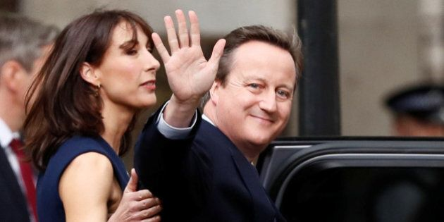 Britain's outgoing Prime Minister, David Cameron with his wife Samantha, waves in front of number 10...