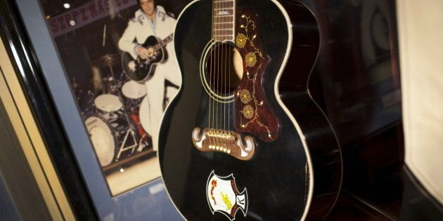 A Gibson J-200 acoustic guitar played by Elvis Presley on stage in the 1960s is seen on display at the...