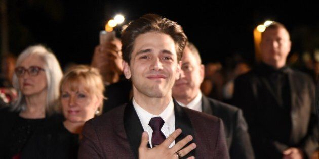 Canadian director Xavier Dolan leaves on May 19, 2016 following the screening of the film 'It's Only...