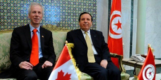Tunisian Foreign Affairs Minister Khemais Jhinaoui, right, greets his Canadian counterpart, Stephane Dion prior to a joint press conference, in Tunis, Saturday, May 21, 2016. (AP Photo/Hassene Dridi)