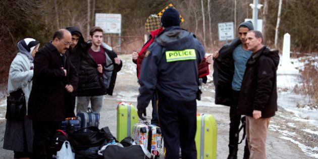 A group that claimed to be from Turkey is met by a Royal Canadian Mounted Police (RCMP) officer after...