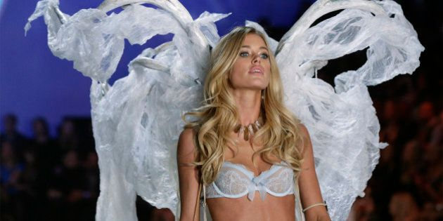 Model Doutzen Kroes presents a creation during the annual Victoria's Secret Fashion Show in New York,...