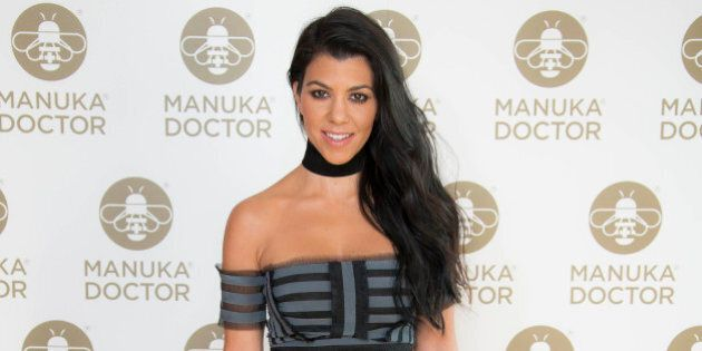 Kourtney Kardashian poses for photographers at a photo call for the launch of Manuka Doctor at the Edition...