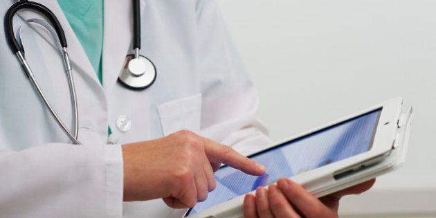 Healthcare professional using digital tablet