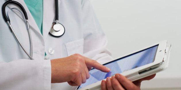 Healthcare professional using digital tablet computer
