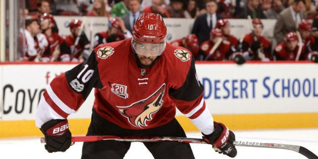 GLENDALE, AZ - MARCH 05: Anthony Duclair #10 of the Arizona Coyotes gets ready during a face off against...