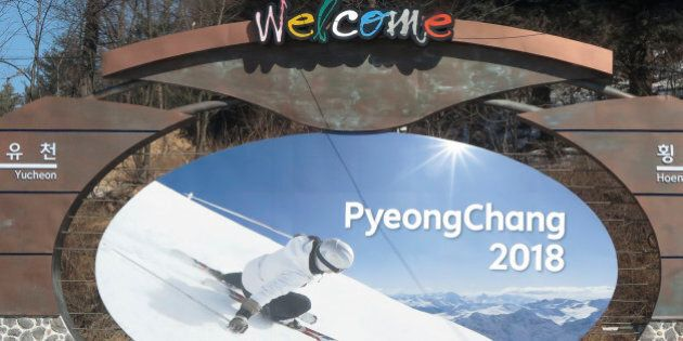 The advertising hoarding promoting the 2018 Winter Olympics stands in the mountain cluster of PyeongChang February 9, 2015. PyeongChang county located in the Taebaek Mountains of Korea, will host the 23rd Winter Olympics from February 9 to February 25 of 2018. The Games are gathered around 13 competition venues in the mountain resort of Alpensia and the coastal city of Gangneung. Picture taken February 9, 2015.           REUTERS/Pawel Kopczynski (SOUTH KOREA  - Tags: CITYSCAPE OLYMPICS SPORT)