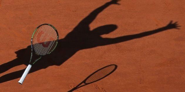 FILE - In this Saturday June 6, 2015 file photo, Serena Williams of the U.S. casts a shadow on the clay...