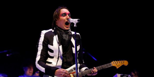 Lead vocalist Win Butler of rock band Arcade Fire performs at the Coachella Valley Music and Arts Festival...