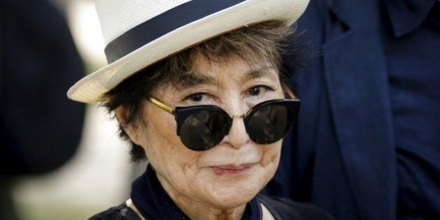 Artist Yoko Ono, widow of John Lennon, attends the unveiling of a tapestry honoring Lennon at Ellis Island...