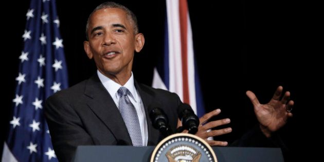 U.S. President Barack Obama speaks during a news conference with British Prime Minister Theresa May after...
