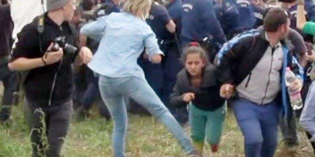 This video grab made on September 9, 2015 shows a Hungarian TV camerawoman kicking a child as she run...