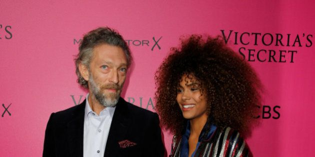 Actor Vincent Cassel (R) and his partner Tina Kunakey pose during a photocall before the 2016 Victoria's...