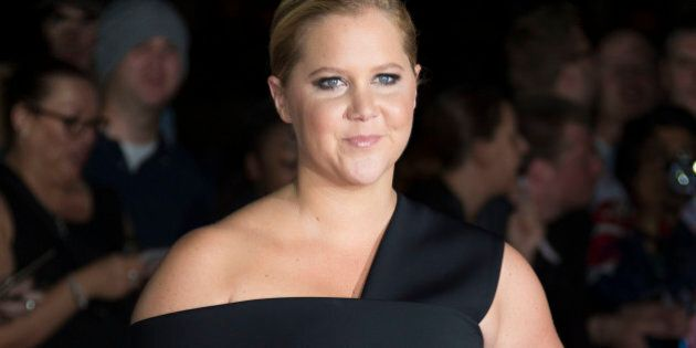 Comedian Amy Schumer poses for photographers upon arrival at the GQ magazine Awards at the Tate Modern...