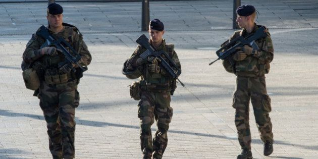 PARIS, FRANCE - MAY 08: Soldiers are securing the area during the Ceremony to Commemorate The 71st Anniversary...