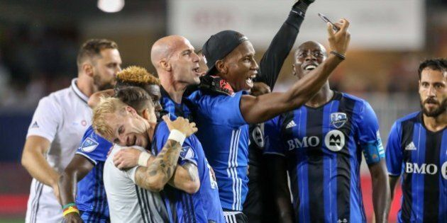 Aug 27, 2016; Toronto, Ontario, CAN; Montreal Impact forward Didier Drogba (11) takes a selfie with teammates after defeating Toronto FC 1-0 at BMO Field. Mandatory Credit: Kevin Sousa-USA TODAY Sports