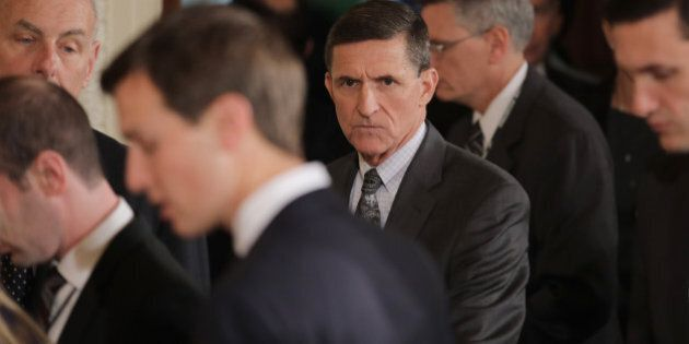 White House National Security Advisor Michael Flynn (C) arrives prior to a joint news conference between...