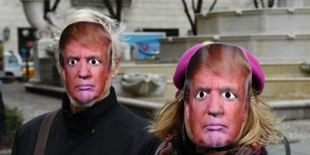 People wearing masks of US President Donald Trump take part in the 32nd Annual April Fools Day Parade...
